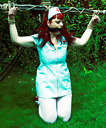 Redhead nurse in outdoor bondage