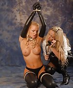 Cute latex blond gets roped and strapon-gagged