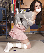 Girl in miniskirt gets roped and tape-gagged