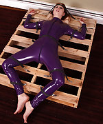 Latex redhead strapped to the cargo pallet and vibed