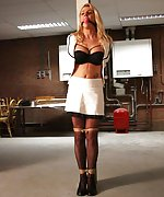 Blonde woman pole-tied and ball-gagged