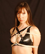 Cindy is bound in rope wearing hot black latex lingerie