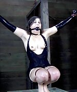 Latex brunette strapped, ass hooked, teased